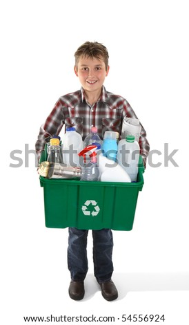 A child holds a recycling bin container full of tins, bottles and papers suitable for recycling.  White background. - stock photo