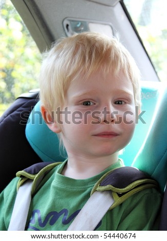 a child in a car - stock photo