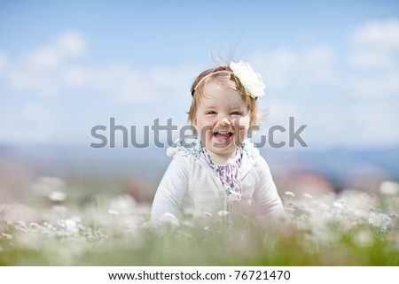 A child in a field of flowers