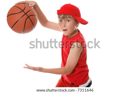 A child in action playing a game of basketball - stock photo