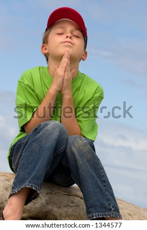 A child in prayer - stock photo