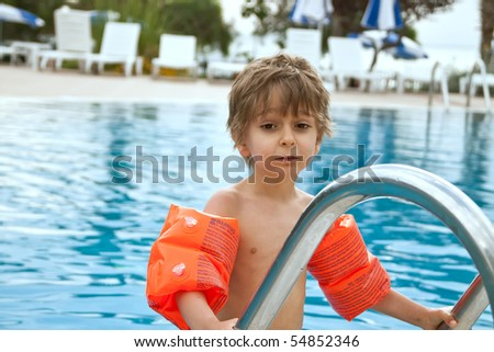 A child in the pool - stock photo