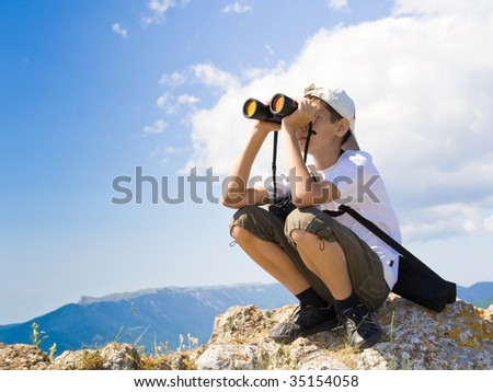 A child looking through binoculars. file corrected. attached release. - stock photo