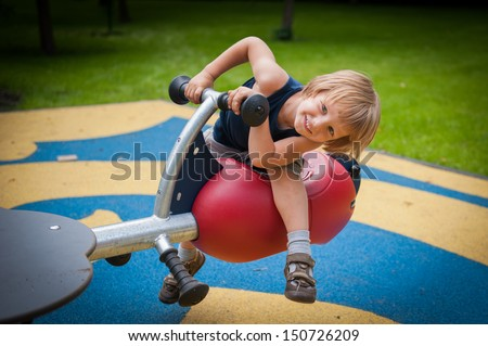 A child on a swing - stock photo