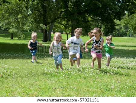 a child or children at play outdoors in a park - stock photo