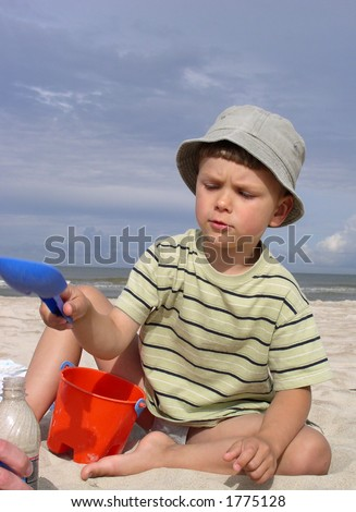 A child playing near the sea - stock photo