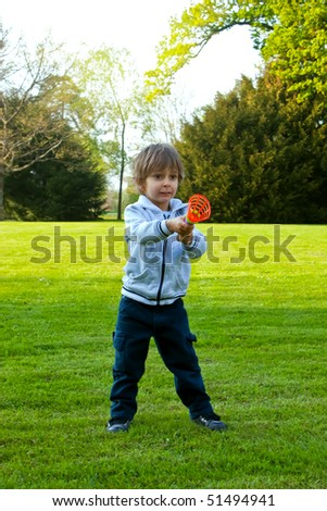 A child playing with a ball in the park - stock photo