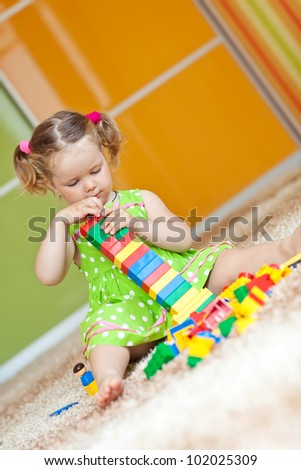 A child playing with blocks - stock photo
