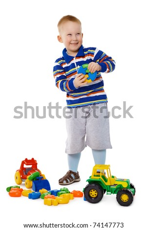 A child playing with plastic toys isolated on white background - stock photo