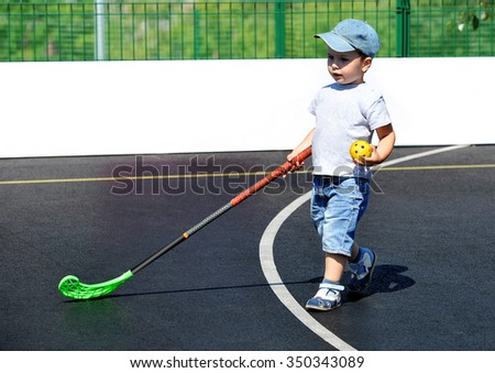 A child plays floorball.Stick and ball games in floorball.