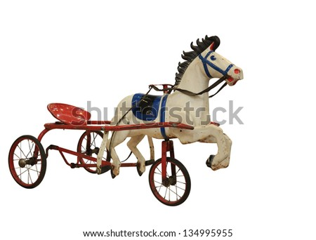 A Child  Red Tricycle made in the form of horses - stock photo