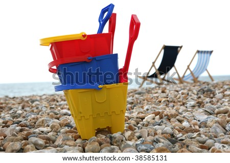 A Child's buckets and spades on the pebble beach at Bognor Regis Sussex