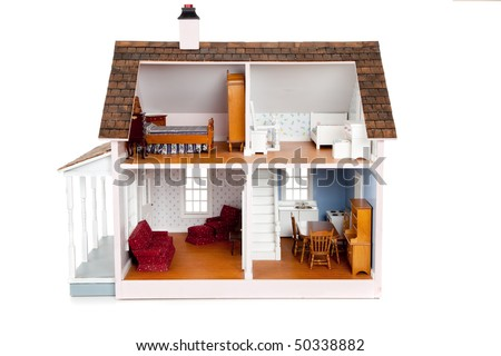 A Child's doll house with furniture on a white background - stock photo