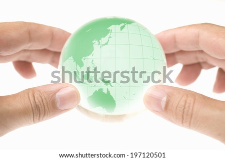 A Child'S Hand Holding A Globe - stock photo