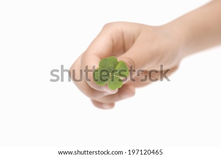 A Child'S Hands And A 4-Leaf Clover - stock photo