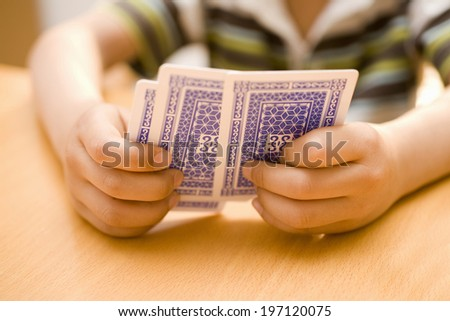 A Child'S Hands Having A Trump - stock photo