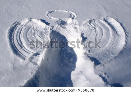 A Child's Snow Angel. - stock photo