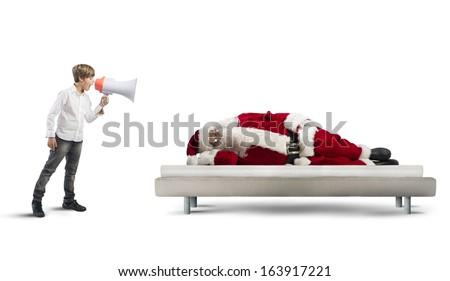 A child wake up asleep Santa Claus - stock photo