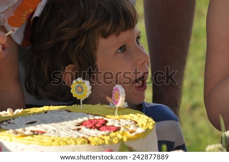 A child with a lollipop. The boy with the cake for the birthday
