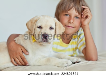 A child with a pet