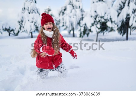 a child with all the forces running through the snow and laughing