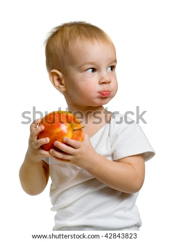 A child with an apple - stock photo
