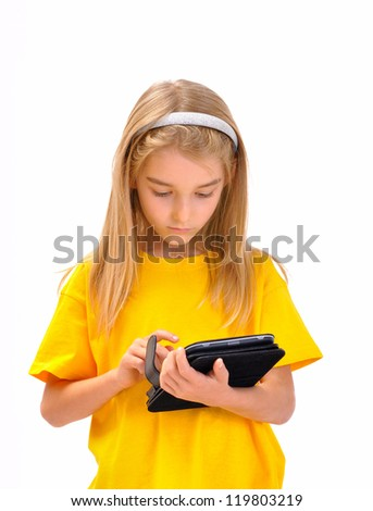 A child with an e-book - stock photo