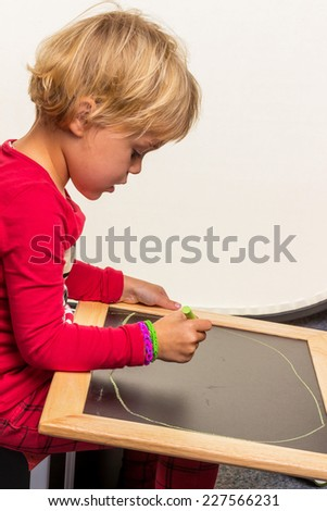 a child with an empty blackboard.
