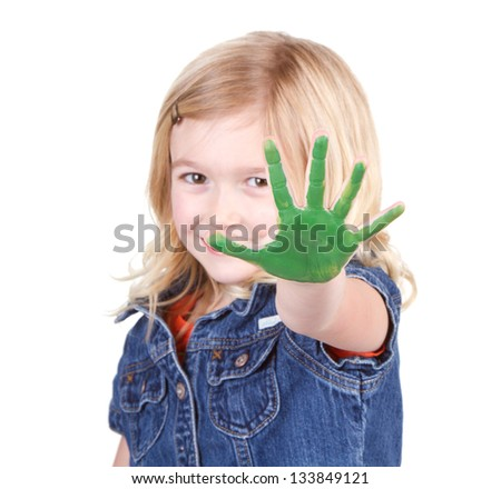 A child with green paint on her hand isolated on a white background - stock photo