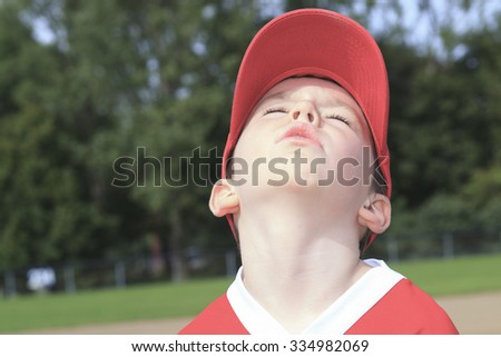 A children baseball player don't want to play - stock photo