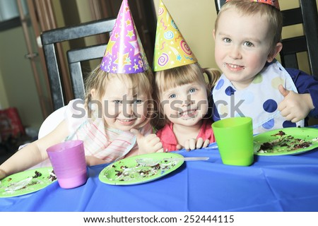 A children birthday with the kid eat cake. - stock photo