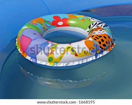 A children's lifebuoy in a pool - stock photo