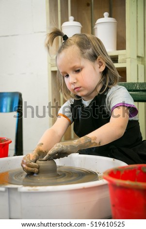 a children's workshop on sculpting utensils in pottery