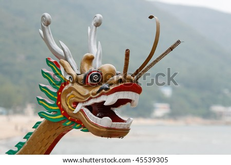 A Chinese dragon head of a dragon boat - stock photo