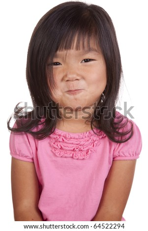 A chinese girl has a funny expression on her face.