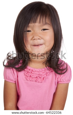 A chinese girl is posing and smiling. - stock photo