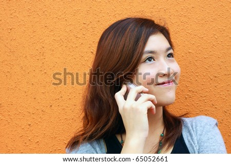 A Chinese girl who is talking in phone