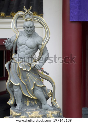 A Chinese God that Guarding the Buddha Tooth Relic Temple and Museum at Chinatown in Singapore, South East Asia. - stock photo