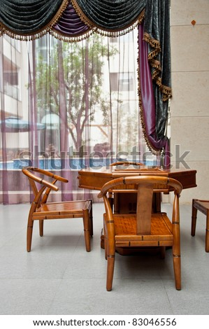A Chinese living room with bamboo table and chairs