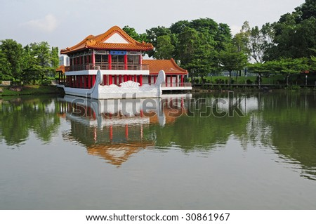 A Chinese Style Pavilion In A Lake
