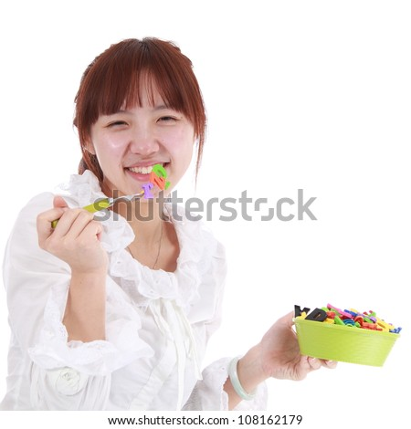 A Chinese woman is eating many letters in her bowl.