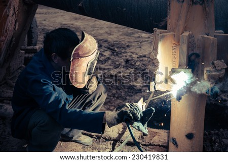 A Chinese workers, are the field welding