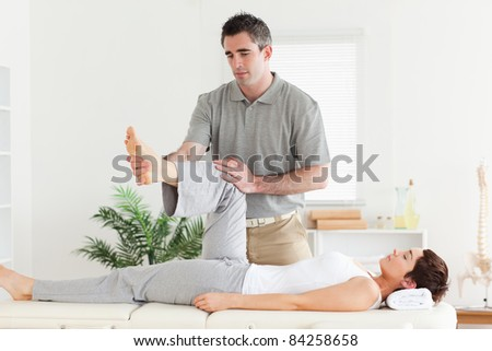 A chiropractor is working with a customer - stock photo