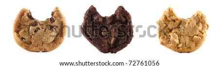 A chocolate chip, double chocolate and macedonia nut cookie with bites out of them on a white isolated background. - stock photo