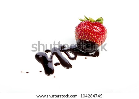 A chocolate-dipped strawberry on a white background