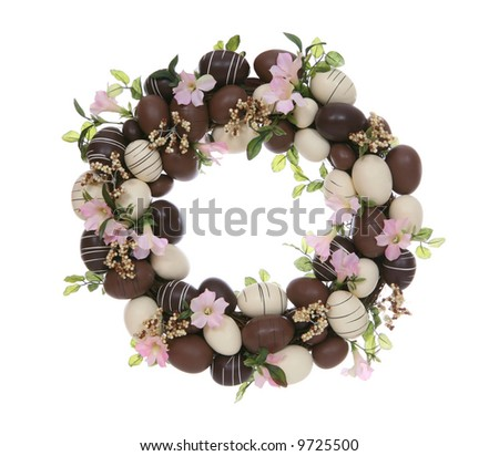 A chocolate easter egg wreath isolated over white - stock photo