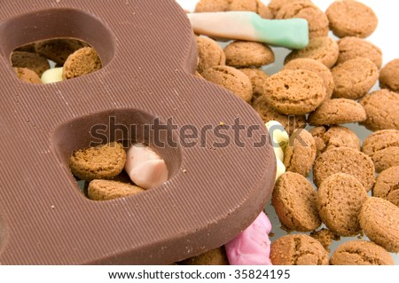 A chocolate letter with Sinterklaas candy isolated on white background - stock photo