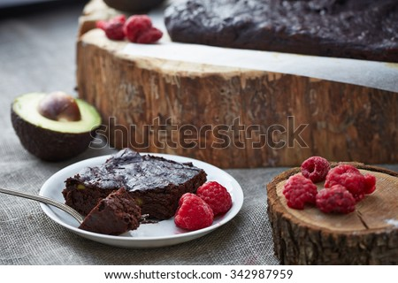 a chocolate pie on a piece of parchment on the wood - stock photo