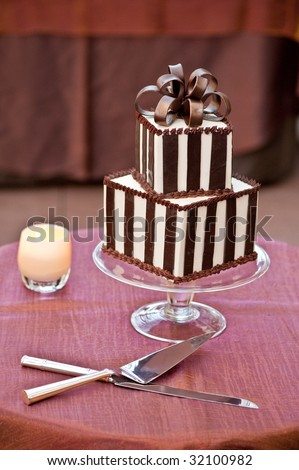 A Chocolate Wedding Cake with Cutting Knifes - stock photo