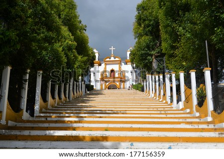A Christian Catholic chapel on a hill with colorful steps in San Cristobal de las Casas, Chiapas, Mexico - stock photo